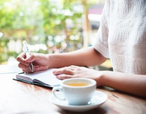 writing in a cafe